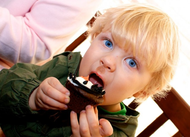 boy eating cupcake
