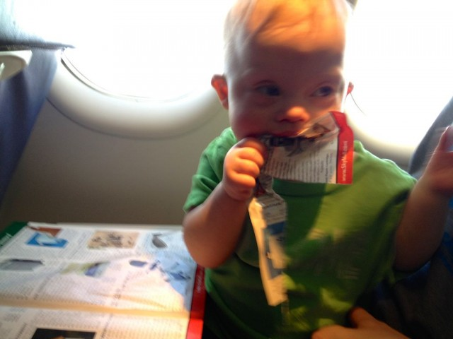 eating a skymall cute baby on a plane