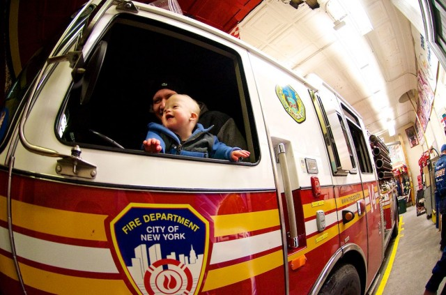 baby-riding-in-firetruck-fire-truck-nyc-new-york