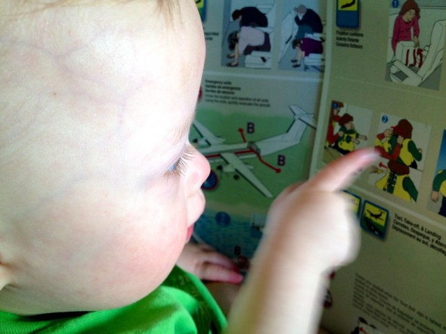 baby kid reading airplane flight instructions down syndrome