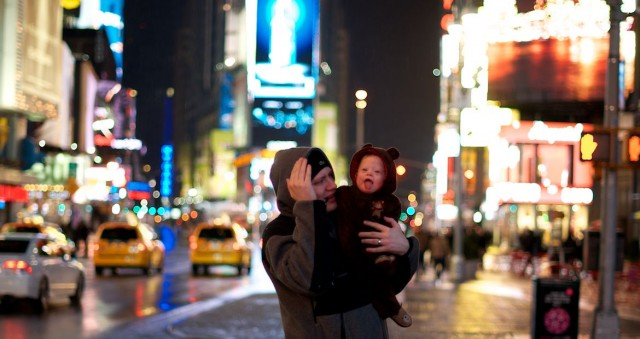 dad-holding-baby-times-square-nyc