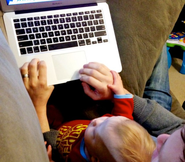 down-syndrome-child-boy-using-computer-mac-keyboard