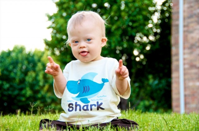 down-syndrome-child-dancing-cute-boy