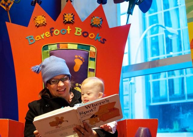 mom-reading-to-son-baby-down-syndrome-fao-schwarz