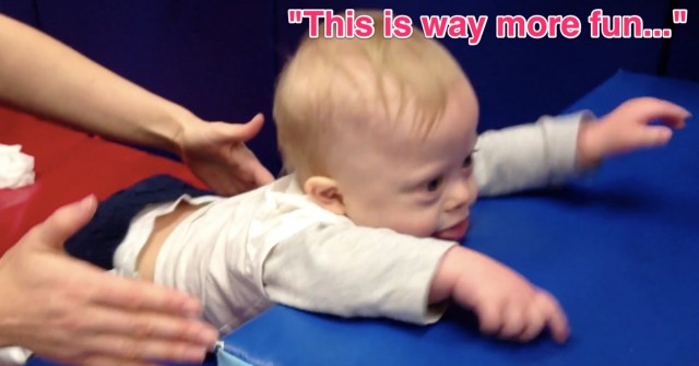 baby down syndrome working hard physical therapy