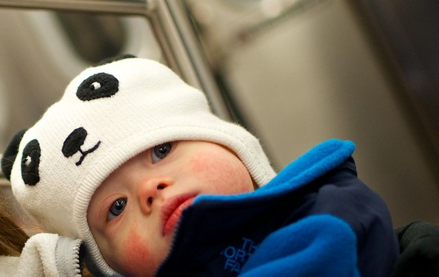cute baby on New York subway train