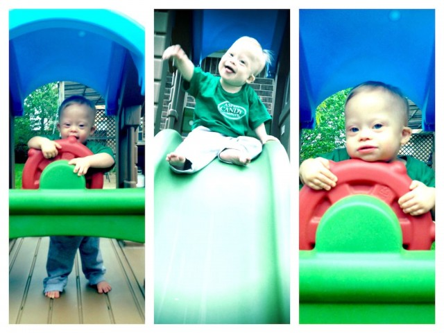 baby-down-syndrome-playing-slide-outside