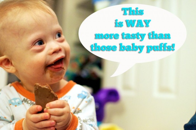 baby eating tim tam frist time chocolate candy bar