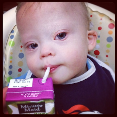 juice box drinking from straw kid boy baby down syndrome