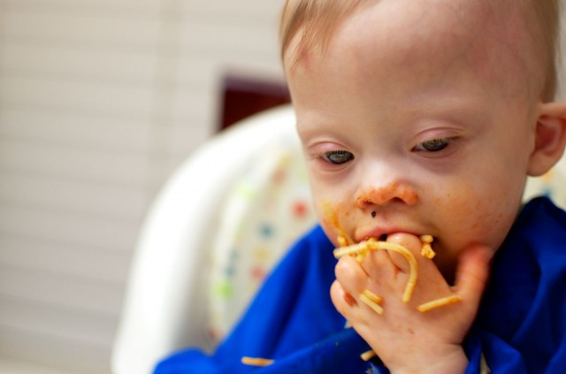 self-feeding-spaghetti-baby-child-down-syndrome 4