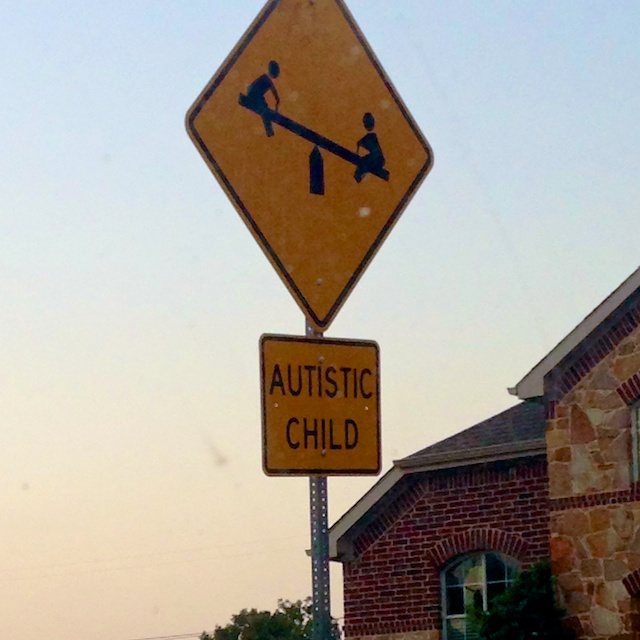 autistic child street sign special needs
