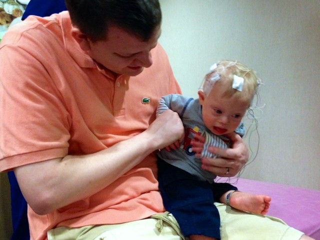 baby getting eeg neurologist downs