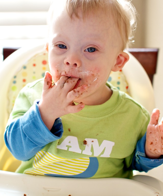 baby down syndrome eating birthday cake