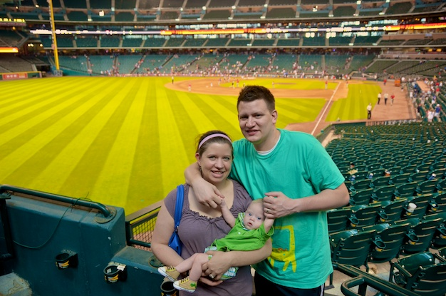 Parents with a son born with down syndrome at an astros game