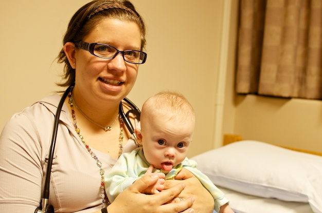 Our son with down syndrome visting his mom pediatrician at the hospital
