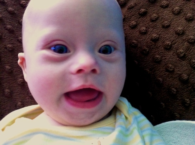 Our Son is a cute baby with Down Syndrome and blue eyes