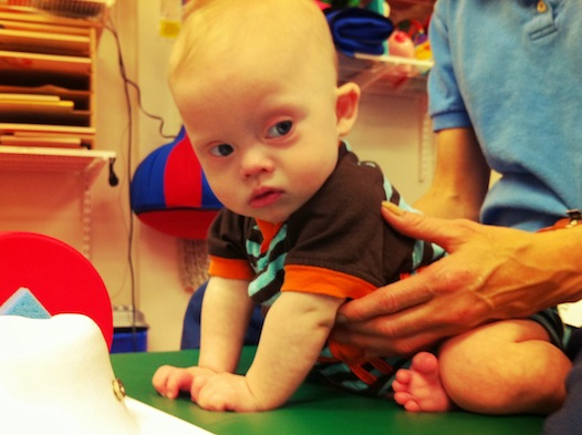 our baby who was born with down syndrome at physical therapy
