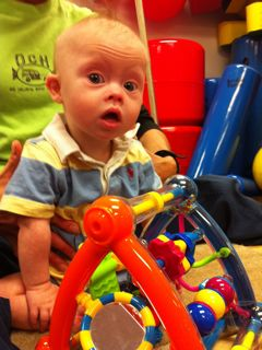 Our son born with Down Syndrome at Physical Therapy