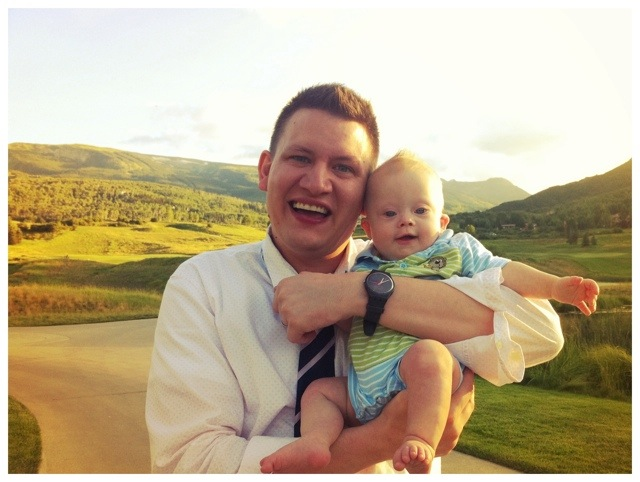 father and son of boy with down syndrome in mountains in colorado