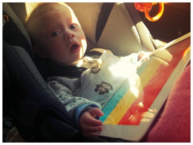 boy with down syndrome using developmental iPad app