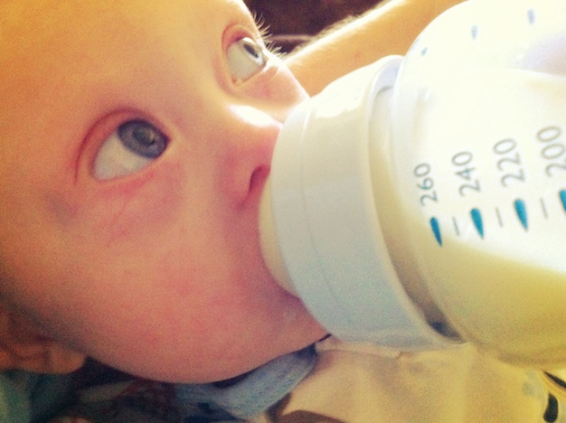 Our son born with down syndrome drinking his bottle