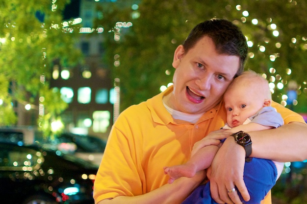 father playing with son with down syndrome in down town fort worth