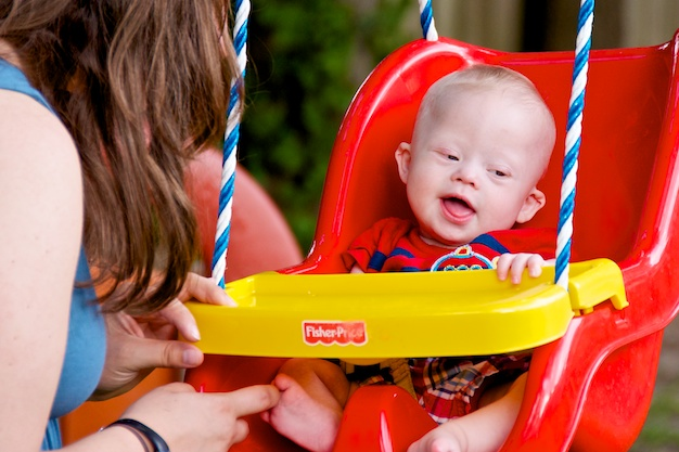Our baby boy with down syndrome really like this red swing!