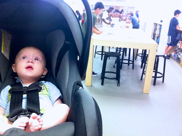 Boy with down syndrome buying mom a gift at the apple store