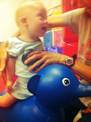 riding elephant at physical therapy down syndrome