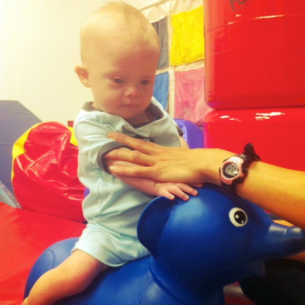 Our son who was born with down syndrome using the inflatable elephant at physical therapy