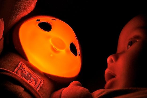 our boy likes sleeping with his glow glo worm glowworm