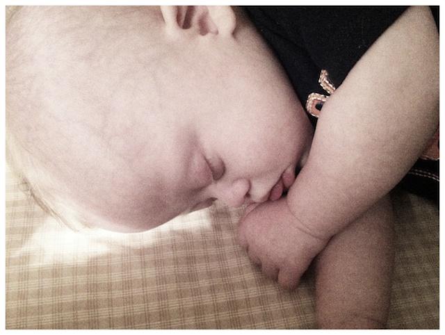 cute downs down syndrome baby boy sleeping