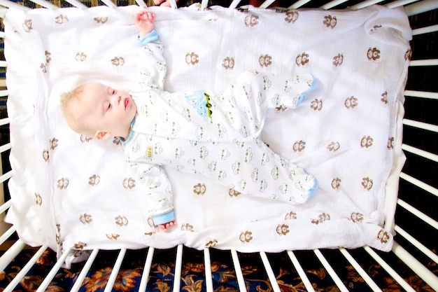 baby boy with down syndrome sleeping in hotel crib