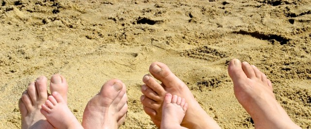 down syndrome family feet sand beach