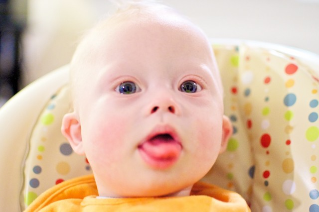 child with down syndrome sticking tongue out