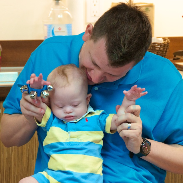 library story time down syndrome baby boy ring bells