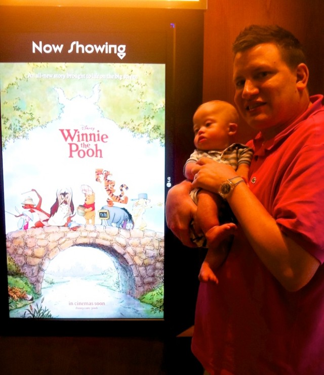 father and son with down syndrome at winnie the pooh