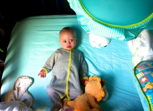 baby boy downs down syndrome sleeping lying crib