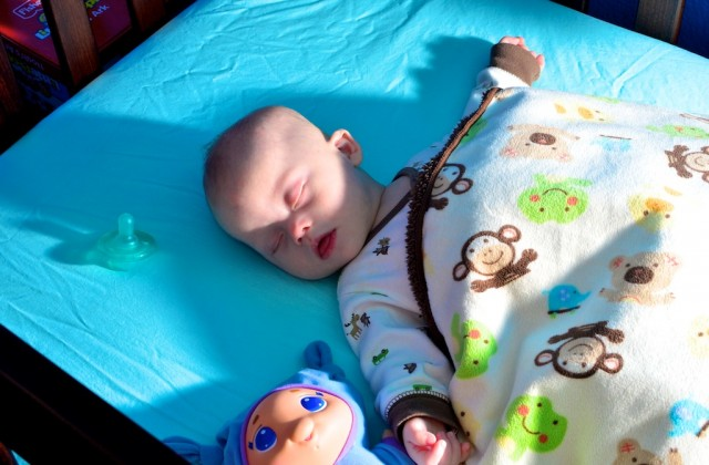 baby with down syndrome sleeping peacefully in crib