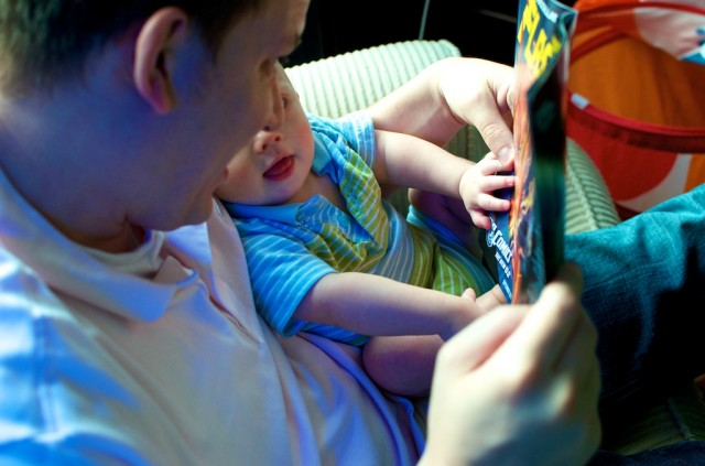 Boy with downs down syndrome reading comic book