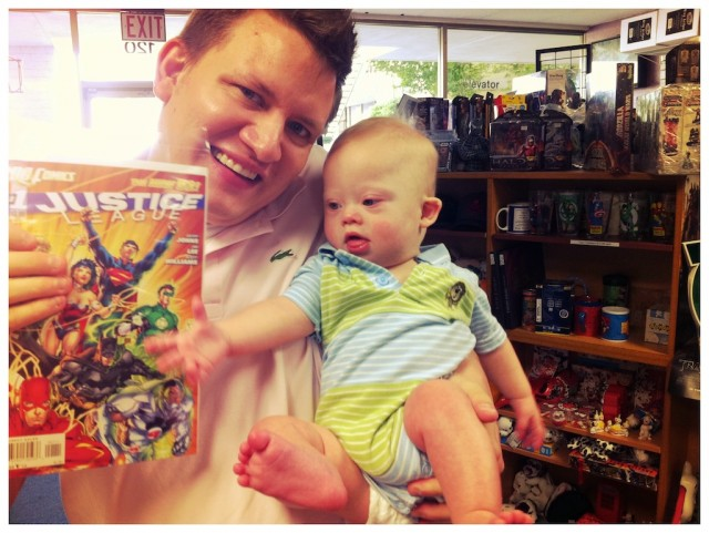 Father and son buying the new 52 dc jla comic book