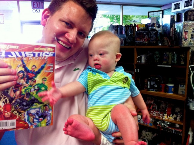 father buying his son his first comic book