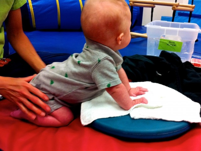 boy with down syndrome exercising at physical therapy