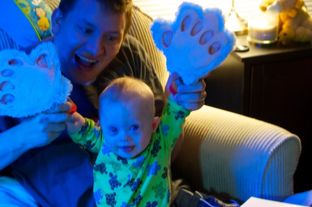 child with downs syndrome tickle monster gloves