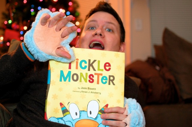 dad reading tickle monster to his son born with down syndrome