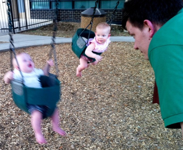 down syndrome kid father son child baby playing swinging