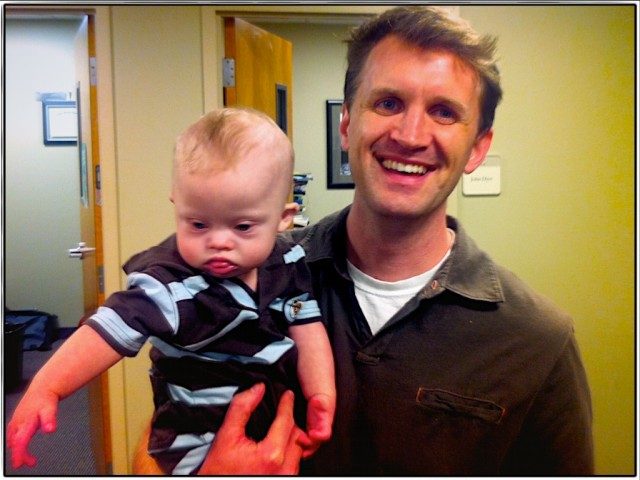 john dyer hold baby with down syndrome at dallas theology seminary