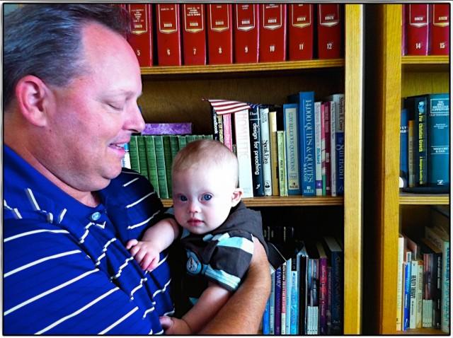 paul pettit dynamic dad holding cute baby