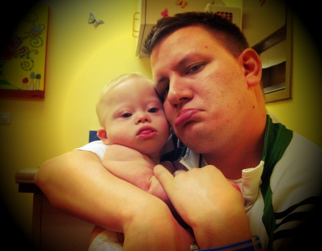 baby down syndrome father son flu shot