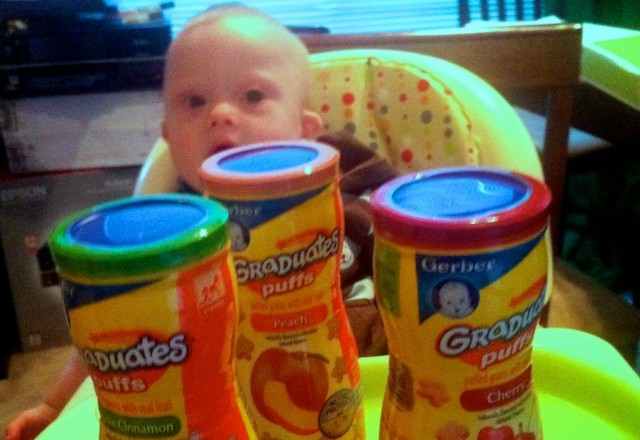 down syndrome baby eating gerber graduates puffs